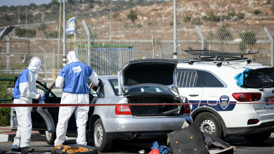 Israeli soldiers and police inspect the scene of a car-ramming attack south of Nablus, on Sept. 2, 2020. Photo by Sraya Diamant/Flash90.