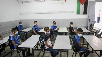 Palestinian students arrive to their first day of school in Nablus, West Bank ,on September 6, 2020. Photo by Nasser Ishtayeh/Flash90.