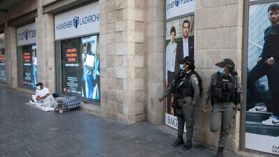 Israeli Border Police patrol Jaffa Road in Jerusalem's city center to prevent lockdown violations, Sept. 23, 2020., Photo by Nati Shohat/Flash90.