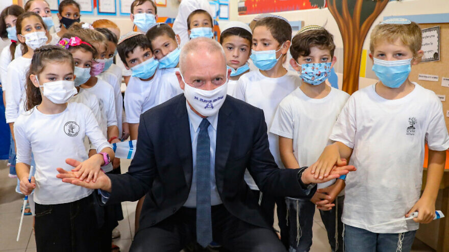 Israeli Education Minister Yoav Gallant visits kids on the first day of the school year in Mevo Horon on Sept. 1, 2020. Photo by Marc Israel Sellem/POOL.
