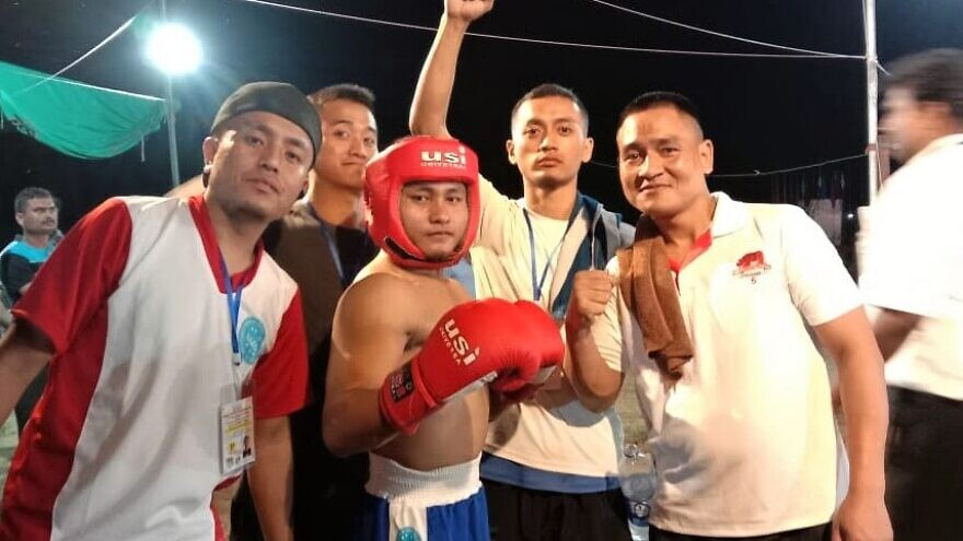 """Obed Hrangchal, 26, of India (center) has already won two gold, seven silver and two bronze national medals in Wushu (Chinese Kungfu), kickboxing, Muay Thai (""""Thai boxing"""") and karate. Credit: Courtesy of Shavei Israel."""