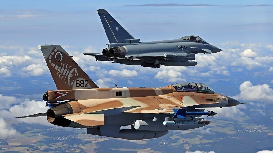 Israeli F-16s and German Eurofighter jets fly side by side in the historic Memory For the Future joint flyover in August. Credit: Bundeswehr / Stefan Petersen