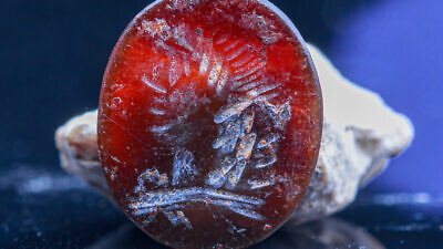 This 2,000-year-old gem seal bearing the image of Apollo was found in earth excavated from the foundations of the Western Wall in the Old City of Jerusalem. Photo by Eliyahu Yanai-City of David.