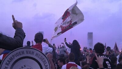 Ajax soccer fans celebrating the club's 30th Dutch national championship in 2011. Credit: Wikimedia Commons.