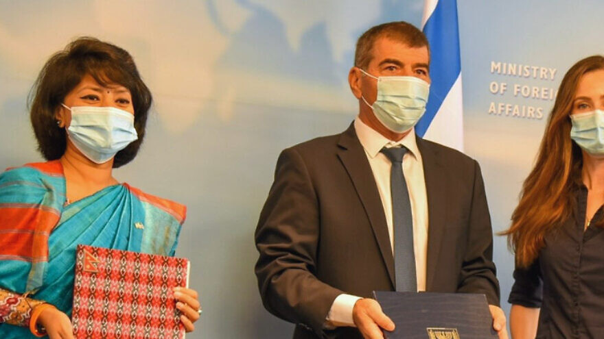 Israeli Foreign Minister Gabi Ashkenazi with Nepalese Ambassador H.E. Anjan Shakya (left) at the signing ceremony on Sept. 30, 2020. Credit: Israeli Ministry of Foreign Affairs.