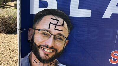 A campaign sign for Seth Blattman, a Jewish Democratic candidate running for Arizona Senate, was vandalized with anti-Semitic graffiti, October 2020.  Source: Seth Blattman/Twitter.