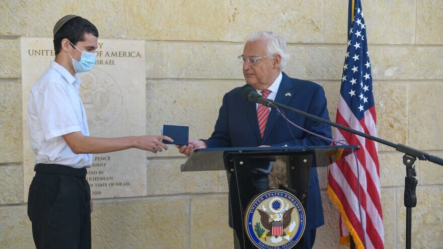 "U.S. Ambassador to Israel David Friedman hands the first U.S. passport with ""Israel"" listed to Jerusalem-born American citizen Menachem Zivotofsky at the U.S. embassy in Jerusalem on Oct. 30, 2020. Source: David M. Friedman/Twitter."