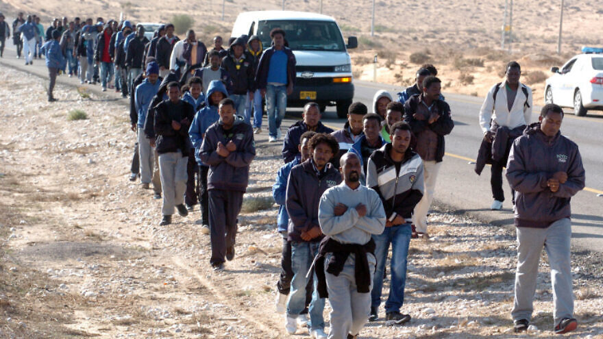 """Sudanese refugees in Israel march in protest against the new """"Holot"""" detention camp for illegal migrants on Dec. 19, 2013. Photo by Flash90."""