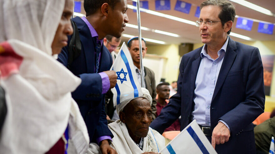 Jewish Agency chairman Isaac Herzog welcomes members of the Falashmura community as they arrive at Ben Gurion Airport on Feb. 4, 2019. Photo by Tomer Neuberg/Flash90.