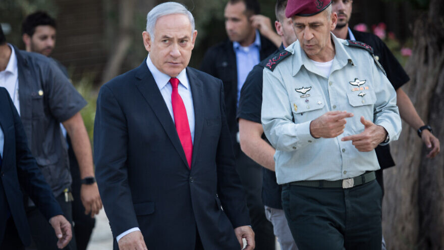 Israeli Prime Minister Benjamin Netanyahu speaks with Israel Defense Forces Chief of Staff Lt. Gen. Aviv Kochavi during an event honoring outstanding IDF reservists at the President's Residence in Jerusalem on July 1, 2019. Photo by Hadas Parush/Flash90.