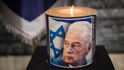 A memorial candle lit during a ceremony commemorating the 24th anniversary of the assassination of Israeli Prime Minister Yitzhak Rabin, at the president's residence in Jerusalem on Nov. 10, 2019. Photo by Hadas Parush/Flash90.