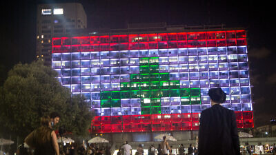 The Tel Aviv municipality on Rabin Square is lit up with the Lebanese flag on Aug. 5, in solidarity with the civilians killed in multiple explosions in Beirut the day before, on Aug. 5, 2020. Photo by Miriam Alster/Flash90.