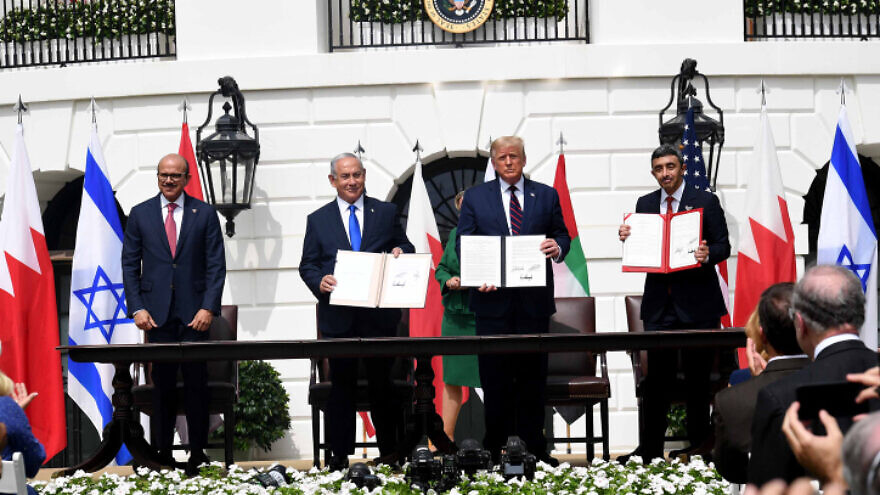 Israeli Prime Minister Benjamin Netanyahu, U.S. President Donald Trump, UAE Foreign Minister Abdullah bin Zayed Al Nahyan and Bahraini Foreign Minister Abdullatif bin Rashid Al Zayani hold up the Abraham Accords, during the signing ceremony at the White House, Sept. 15, 2020. Photo by Avi Ohayon/GPO.