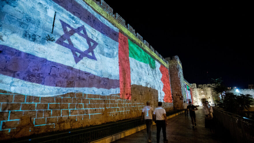 The flags of the U.S., United Arab Emirates, Israel and Bahrain are screened on the walls of Jerusalem's Old City, on September 15, 2020. Photo by Yonatan Sindel/Flash90