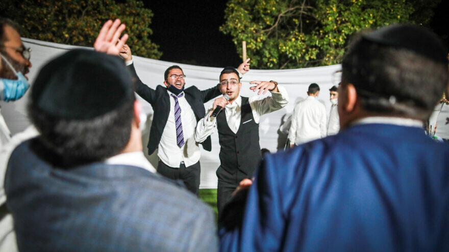 The groom dances with family and friends during his wedding in Giv'at Ze'ev, near Jerusalem, after violence erupted when police attempted to shut down the celebrations for violating coronavirus lockdown regulations, Oct. 14, 2020. Photo by Flash90.