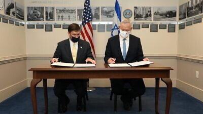 "U.S. Secretary of Defense Mark Esper and Israeli Defense Minister Benny Gantz sign an agreement that Gantz said will ""ensure the quality edge of the Israeli defense establishment and the IDF in the coming decades."" Credit: Israeli Ministry of Defense."