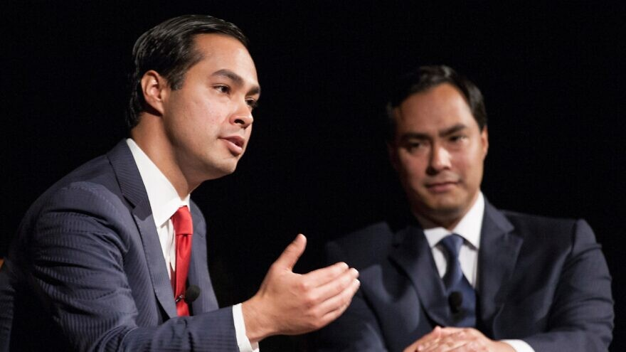 """Rep. Joaquin Castro (D-Texas) and his twin brother, San Antonio Mayor Julian Castro, discuss politics and demographics during a conversation moderated by Evan Smith, CEO and editor in chief of """"The Texas Tribune,"""" the evening's co-sponsor, on April 2, 2013. Credit: Lauren Gerson via Wikimedia Commons."""