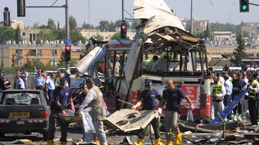 Israeli paramedics and police at the scene of a suicide bombing that killed 19 and injuring 74 on a bus in Jerusalem. Hamas claimed responsibility for the attack, June 18, 2002. Photo by Flash90.