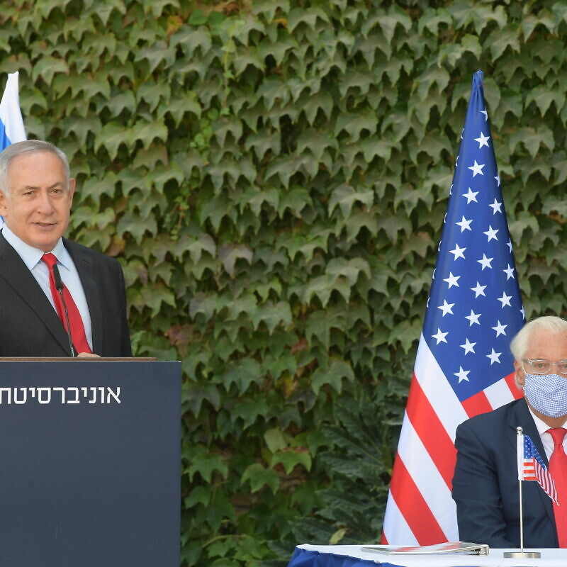 Israeli Prime Minister Benjamin Netanyahu delivering remarks at Ariel University, along with U.S. Ambassador to Israel David Friedman. Credit: Amos Ben-Gershom/GPO.