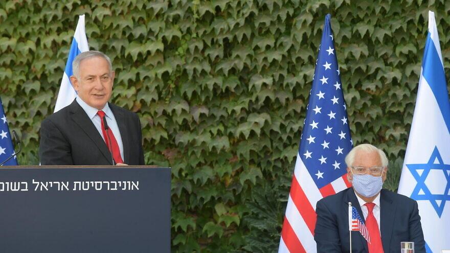 Israeli Prime Minister Benjamin Netanyahu delivering remarks at Ariel University, along with U.S. Ambassador to Israel David Friedman. Credit: Amos Ben-Gershom/GPO.