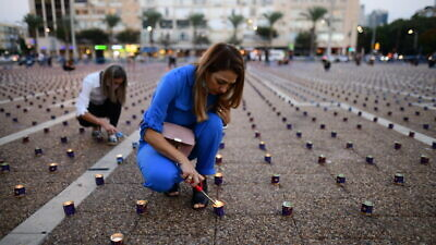 Israelis prepare for a display of 25,000 memory candles in honor of the 25th Memorial Day for the assassination of Prime Minister Yitzhak Rabin at Rabin Square in Tel Aviv on Oct. 29, 2020. Photo by Tomer Neuberg/Flash90.