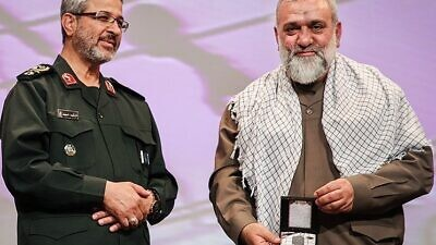 Iranian Brig. Gen. Gholam Hossein Gheyb Parvar (left) and Brig. Gen. Mohammad Reza Naqdi at a ceremony in Tehran, Dec. 12, 2016. Credit: Hamed Malekpour/Tasnim News via Wikimedia Commons.