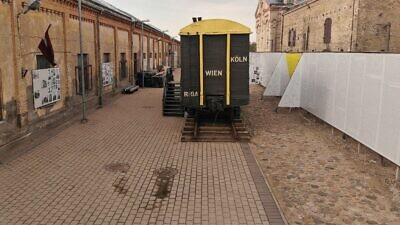 A railroad boxcar or cattle car used by the Nazis to transport Jews during the Holocaust is on view at the Riga Ghetto and Latvian Holocaust Museum. Credit: Shamir Association.