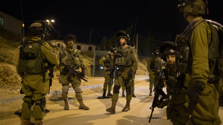 IDF Nachshon Battalion soldiers during an arrest operation in the Duhaisha Refugee Camp, near Bethlehem, on Dec. 8, 2015. Photo by Nati Shohat/Flash90.