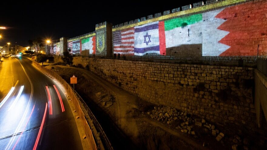 The flags of the U.S., the United Arab Emirates, Israel and Bahrain are screened on the walls of Jerusalem's Old City on Sept. 15, 2020. Photo: Yonatan Sindel/Flash90.