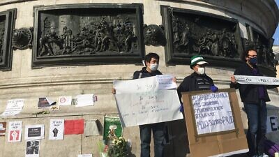 "Protesters wave banners reading ""We are Prof"" in solidarity with murdered teacher Samuel Paty, who was beheaded on Oct. 15, 2020 in Paris for showing a cartoon of the prophet Muhammad in a course on free speech. Source: Twitter/Sophie Sassi."
