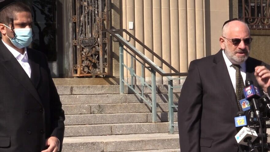 Community activist Yossi Gestetner and Ron Coleman, an attorney with Dhillon Law Group, speak outside the U.S. District Court for the Southern District of New York. Source: Screenshot.