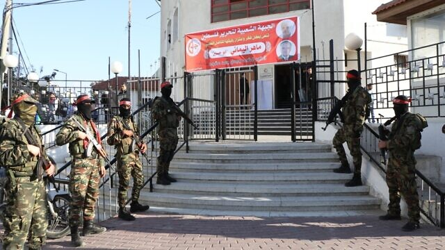Fighters of the PFLP's Abu Ali Mustapha Brigades standing at the entrance of Red Crescent Society for the Gaza Strip's building. Credit: Red Crescent Society for the Gaza Strip.