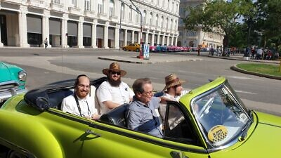 Saul Berenthal (front left), 75, was born and raised in Cuba but left for Miami in 1960, following the 1959 Castro revolution. He is pictured here in Havana, cruising around in a classic 1950s American-made car. Credit: Courtesy.