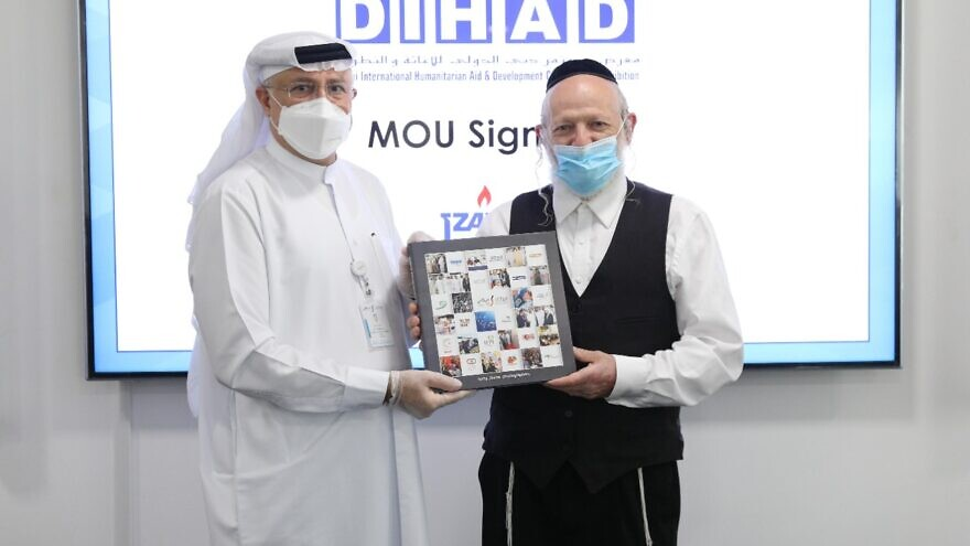 DIHAD executive chairman Abdul Salam al-Madani and ZAKA chairman Yehuda Meshi-Zahav sign a memorandum of understanding in Dubai on Nov. 25, 2020. Photo courtesy of ZAKA.