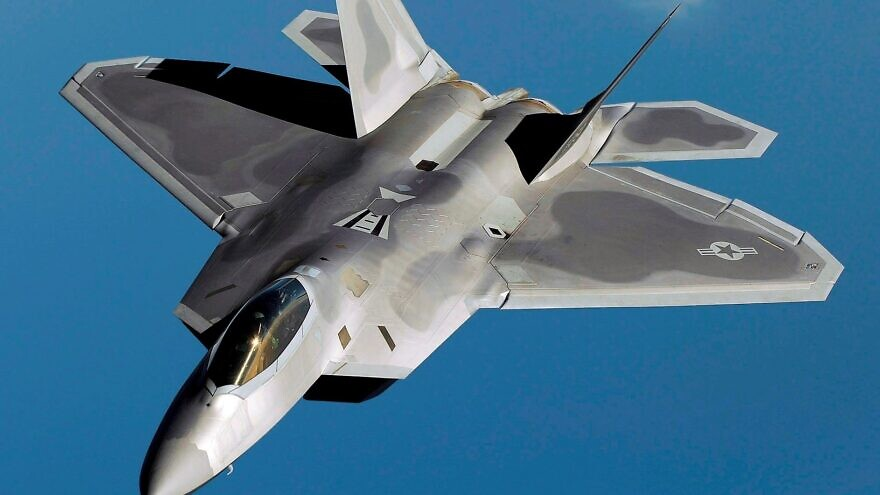 An F-22 Raptor flies over Kadena Air Base, Japan on a routine training mission in 2009. Credit: Master Sgt. Andy Dunaway via Wikimedia Commons.