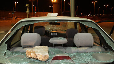 An Israeli car at Kalandia checkpoint outside Jerusalem, after being attacked with stones in Ramallah, Dec. 13, 2007. Photo: Kobi Gideon/Flash90.