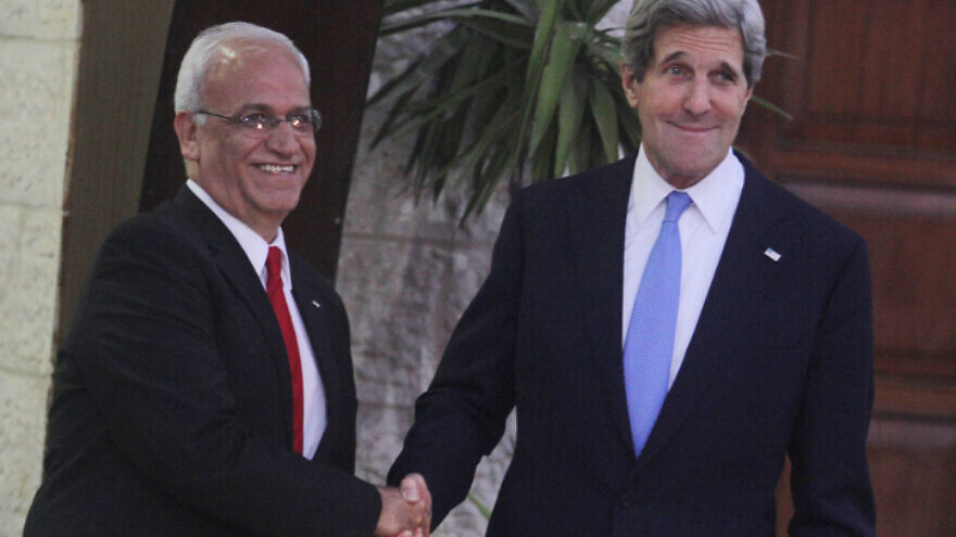 Former U.S. Secretary of State John Kerry with chief Palestinian negotiator Saeb Erekat, prior to Kerry meeting with Palestinian Authority leader Mahmoud Abbas in Ramallah, April 7, 2013. Photo by Issam Rimawi/Flash90.