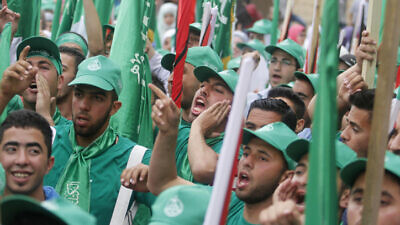 Hamas supporters attend a rally prior to the Student Council elections at Birzeit University, on the outskirts of Ramallah on May 6, 2014. Photo by Issam Rimawi/Flash90.
