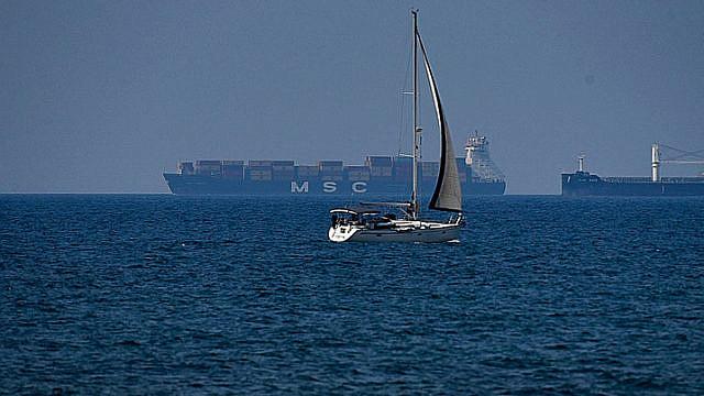 A cargo ship is seen off the coast of the northern Israeli city of Haifa on June 9, 2019. Photo by Meir Vaknin/Flash90