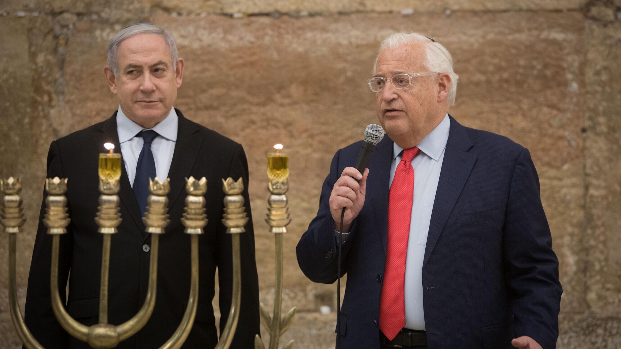 Israeli Prime Minister Benjamin Netanyahu and U.S. Ambassador to Israel David Friedman light Hanukkah candles at the Western Wall on December 22, 2019. Photo by Noam Revkin Fenton/Flash90.