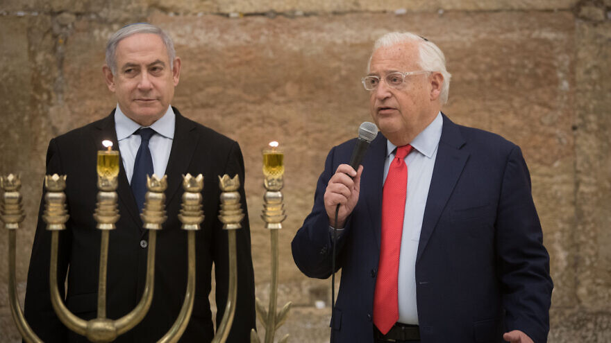 Israeli Prime Minister Benjamin Netanyahu and U.S. Ambassador to Israel David Friedman light Hanukkah candles at the Western Wall on December 22, 2019. Photo by Noam Revkin Fenton/Flash90.