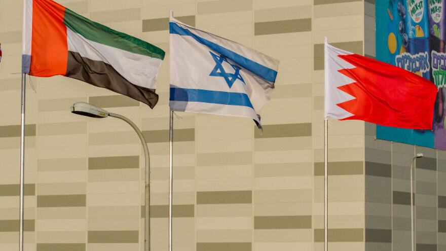 The flags of the United States, the United Arab Emirates, Israel and Bahrain seen on the side of a road in the city of Netanya on Sept. 14, 2020. Photo by Flash90.
