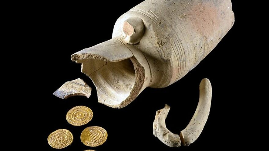 a 1,000-year-old juglet and gold coins from the Fatimid period, unearthed in the Old City of Jerusalem in Oct. 2020. Photo: Dafna Gazit/Israel Antiquities Authority.