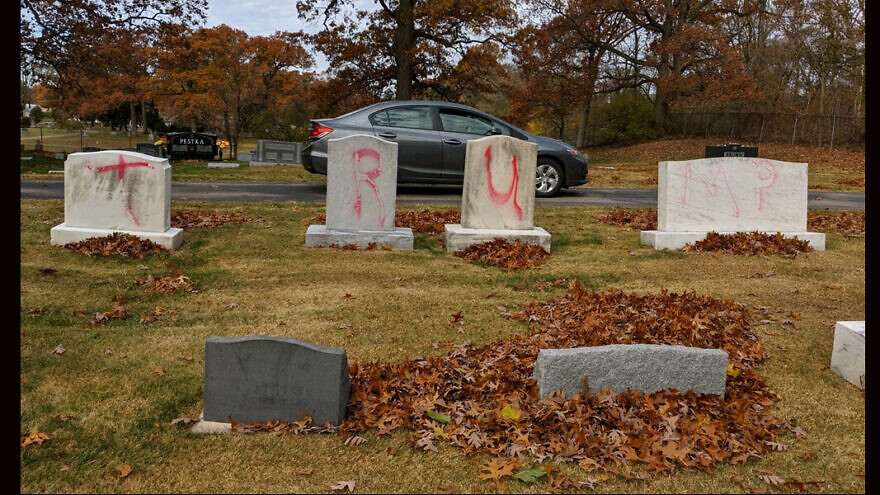 """Headstones tagged with graffiti reading """"TRUMP"""" at a Jewish cemetery in Grand Rapids, Mich. The vandalism was found on Nov. 2, 2020. Courtesy: ADL Michigan."""