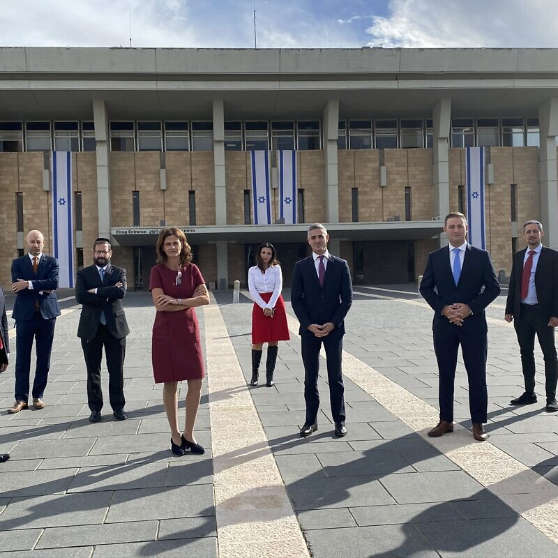 From left: Hillel Neuer, Arsen Ostrovsky, Former MK Dov Lipman, MK Michal Cotler-Wunsh, Deputy Mayor of Jerusalem Fleur Hassan-Nahoum, Avi Mayer, Michael Dickson, Alex Traiman, Yosef Haddad in Jerusalem, Nov. 24, 2020.