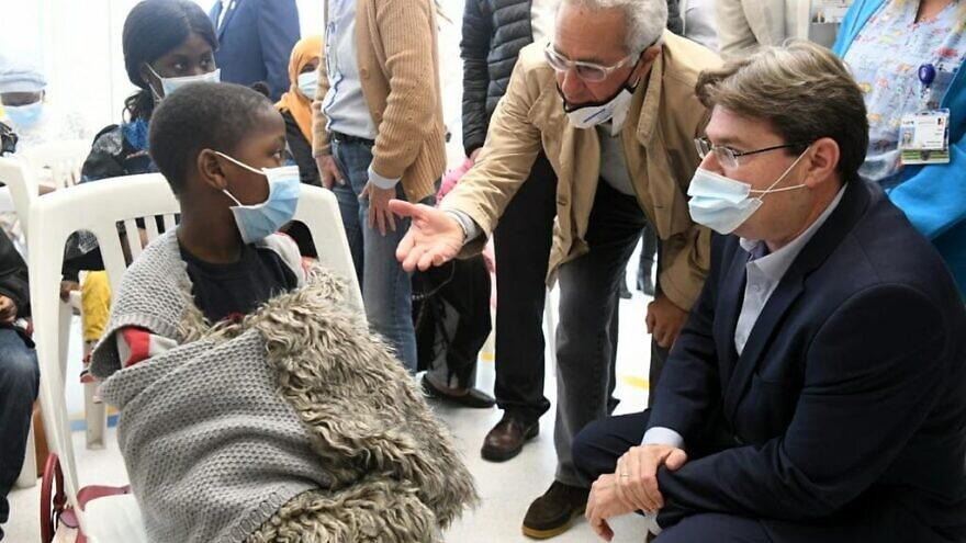 """Israel's Minister of Regional Cooperation Ofir Akunis (right) and philanthropist Sylvan Adams visit the Wolfson Medical Center in Holon and the """"Save a Child's Heart"""" organization on Nov. 26, 2020. Photo by Shlomi Yosef."""