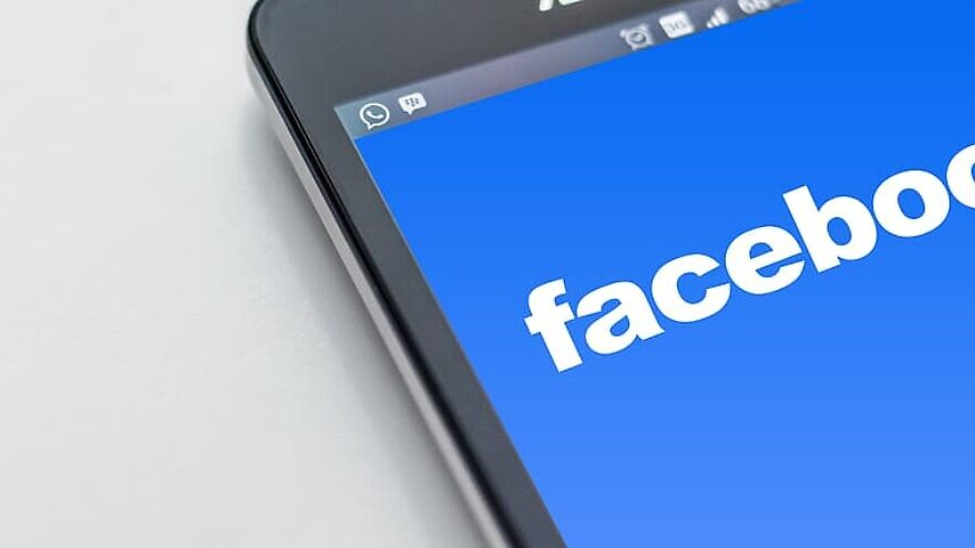 A phone with the Facebook logo. Credit: Pikrepo.