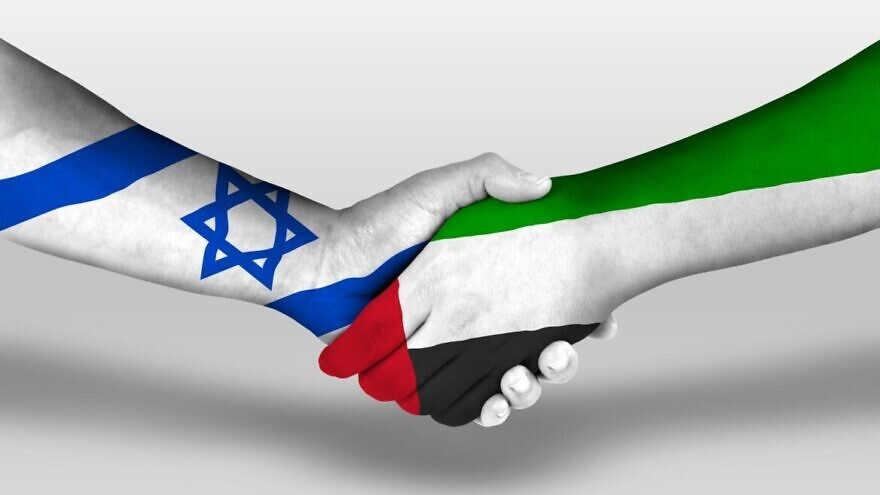 """Israel and the UAE """"holding hands."""" Image via Shutterstock."""