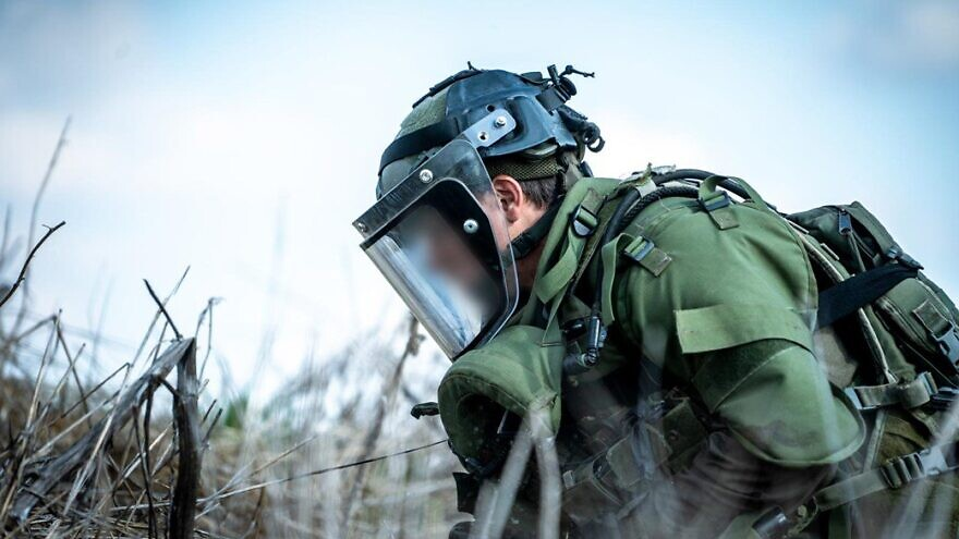 An Israeli soldier neutralizes roadside bombs found on the Israeli side of the Alpha line in the southern Golan Heights, Nov. 17, 2020. Source: IDF Spokesman's Office.