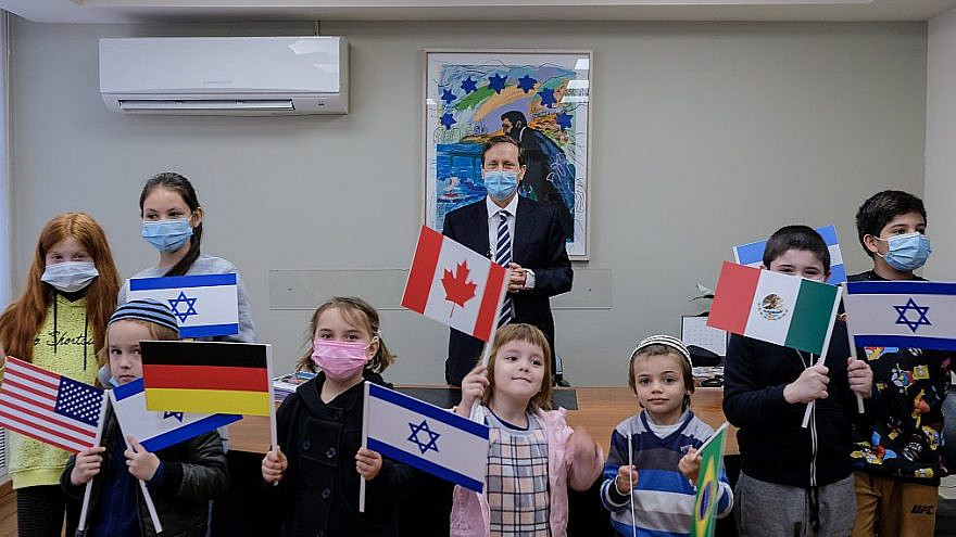 Jewish Agency chairman Isaac Herzog with a group of immigrant children, on Dec. 27, 2020. Photo courtesy of David Salem.